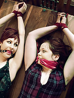 Two girls roped together and gagged