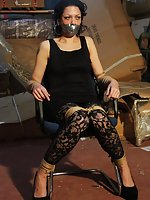 Distressed damsel chair-tied and tape-gagged