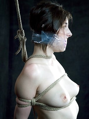 Lovely brunette gets roped and tightly gagged
