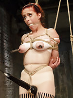 Redhead slut gets roped, pegged, ass-hooked, vibed