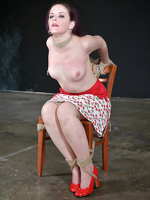 Hot brunette roped to a chair and spanked