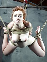 Redhead roped, stripped, tit-clamped, suspended