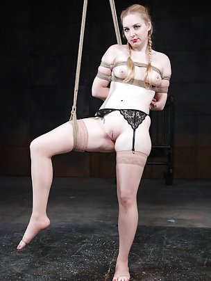 Blonde slut spanked and straponed in predicament bondage
