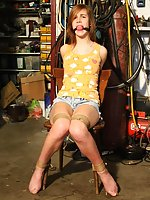 Anouk chair-tied, ball-gagged, tit-grabbed