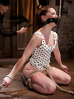 Redhead tied with her gag and hair pulling in two directions