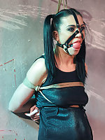 Corazon on a string bound up and harness ball-gagged