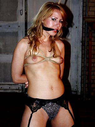 Sexy blonde is roped and cleave-gagged
