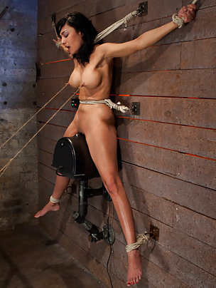 Bound suspended off the ground, stuck on the orgasm machine